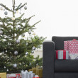 Stock Photo: Christmas presents by tree