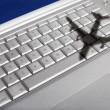 Stock Photo: Shadow of jumbo jet over keyboard