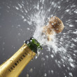 Stock Photo: Champagne bottle popping cork