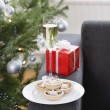 Stock Photo: Glass of champagne and mince pies