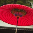 Traditional red umbrella — Stock Photo