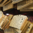 Wooden plaques with prayers and wishes — Stock Photo