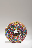 Sprinkles on doughnut — Stock Photo