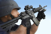 Swat officer aiming gun — Stock Photo