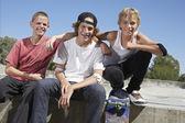 Teenage boys with skateboards — Stock Photo