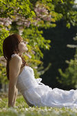 Woman Relaxing in the Grass — Stock Photo