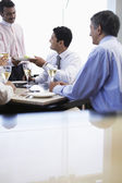 Business man taking meal from waiter — Stock Photo