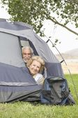 Couple with heads at tent flap — Stock Photo