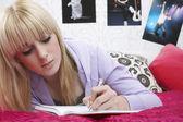 Girl writing diary — Stock Photo