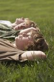 Brothers lying on grass — Stock Photo