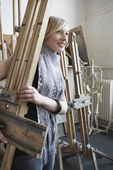 Art student carrying easel — Stock Photo