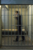 Man in prison cell — Foto Stock