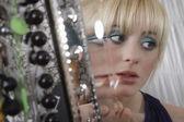 Girl applying lip gloss — Stock Photo