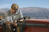 Farmer on tractor — Stock Photo