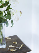 White lilies in vase on table — Stock Photo