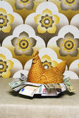Chicken shaped container full of Euros — Stock Photo