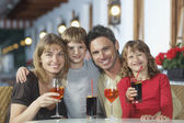 Parents and children  holding drinks — Stok fotoğraf