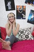 Girl listening to music — Stock Photo