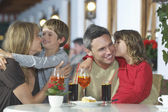 Parents and children embracing — Stock Photo