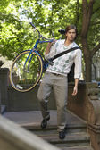 Man carrying bicycle — Stock Photo