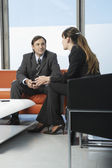 Businessman and woman talking — Stock Photo
