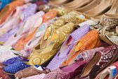 Colorful womens sandals made of camel skins — Stock Photo