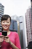 Woman Using PDA — Stock Photo