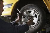 Mechanic Working on Tire — Foto Stock