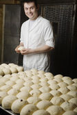 Baker With Balls of Bread Dough Ready to Bake — Stock Photo