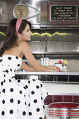 Woman at a Diner Counter — Stock Photo