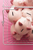 Shopping cart with piggy banks — Stock Photo