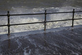 Water crashing over rail — Stock Photo
