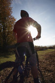 Biker looking at countryside — Stock Photo