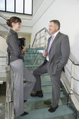 Businessman and woman standing — Stock Photo