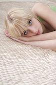 Girl lying on bed — Stock Photo