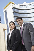 Businesspeople smiling — Stock Photo
