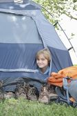 Boy peaks out of tent — Stock Photo