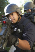 Swat officers aiming guns — Stock Photo