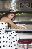 Woman Sitting in a Diner — Stock Photo