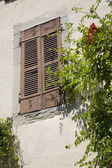 Wall with shutters — Stock Photo