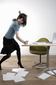 Woman hitting desk — Stock Photo
