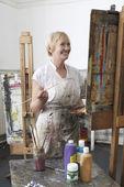 Artist holding paintbrush — Foto Stock