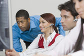 People Wearing Headsets in Office — Stock Photo