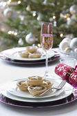 Mince pies on plate on dining table — Stock Photo