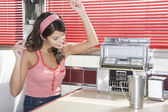 Woman Listening to Music in a Diner — Stock Photo