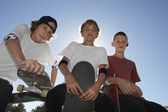 Teenage boys with skateboards — Stock Photo