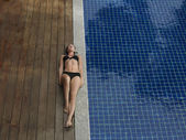 Woman Lying by Swimming Pool — Stock Photo