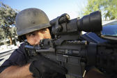 Swat officer aiming gun — Stock Photo