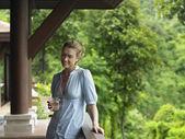 Woman Beneath Veranda — Stock Photo
