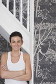 Woman  leaning against staircase — Stock Photo